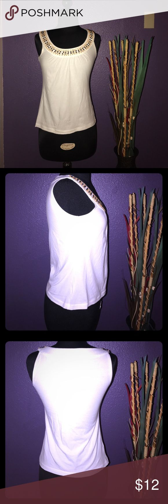 Anne Taylor LOFT white top size XSP Excellent condition cute XSP (extra small petite) white tank top with beaded design around the neck line. No holes rips or tears. All beads are all intact!! This shirt I would wash and always hang dry to prevent beads from falling off in the dryer. LOFT Tops Tank Tops