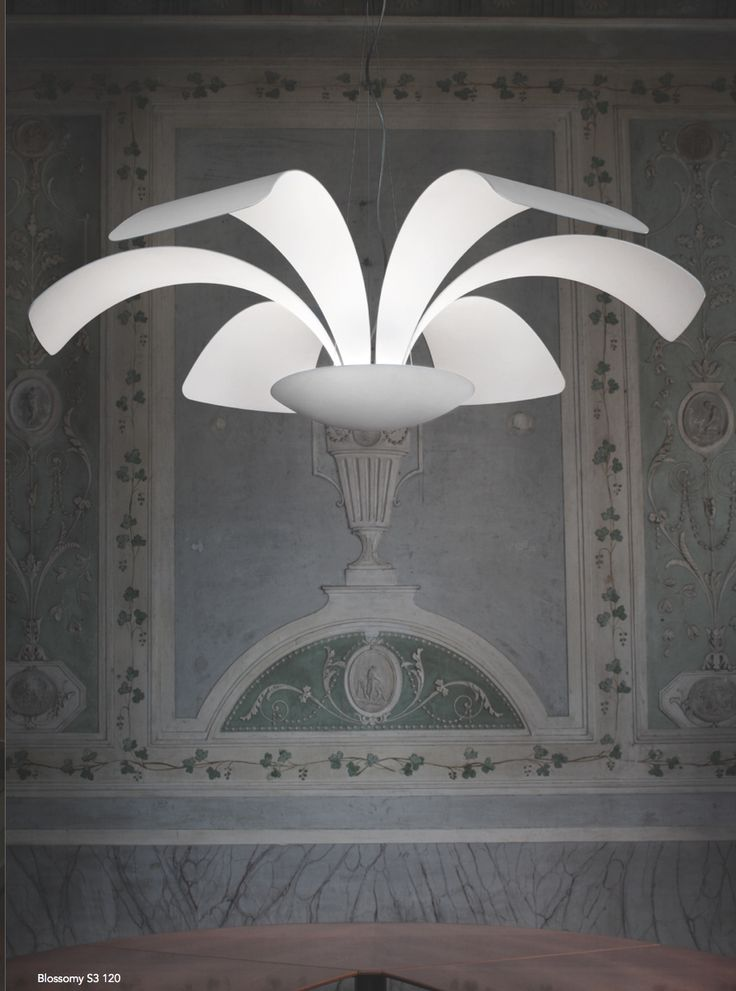 One of the newest styles available. Simple, elegant but curvy and sensual. Ceiling light with indirect light reflecting from the inside of the bowl onto the overhead petals and then back down into the room. Electricity cable is shown as curving but can be totally straight like the supporting cables.