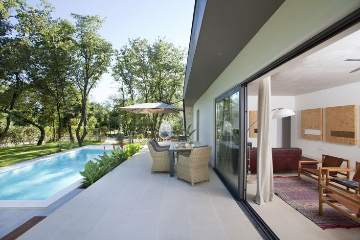 BRERA collection by #CeramicaSantAgostino was used for the outdoor flooring of this #villa, project by Ana Dekaris architect #homedecor #outdoor #pool #swimmingpool #villas #glass #nature #holidays
