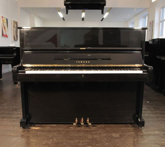 A 1970, Yamaha U1 upright piano with a black case and polyester finish at Besbrode Pianos. This Yamaha is in our summer sale WAS: £2600 NOW: £2300
