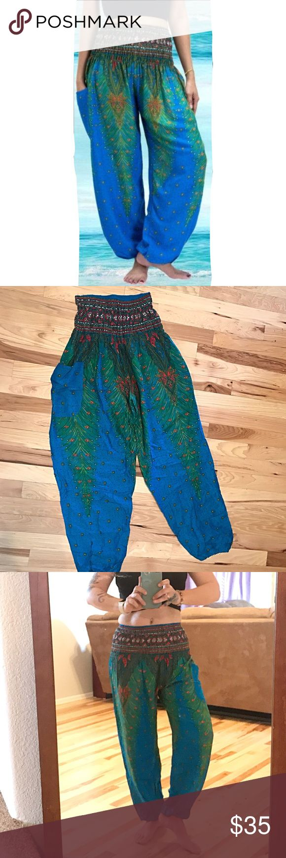 Hippie Boho Harem Pants Blue Green Festival Yoga Hippie Boho Harem Pants Blue Green Festival Yoga Wise leg Pants. Wide elastic band. Waist unstretched is 12 inches stretched is 16 inches inseam is 27 inches and length from top of waist to bottom hem measures 42 inches. One size fits most. Fits Small Medium Large and XL. New in package. Pants Wide Leg