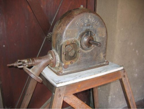 Pelton wheel water motor. We had REAL knowledge back in the day.