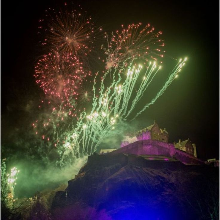 Up to 75,000 people joined the singing of Auld Lang Syne at the conclusion of the Edinburgh street party  - Scotland marks the new year - January 1, 2018.  Scotland has been celebrating Hogmanay and the coming of the new year.