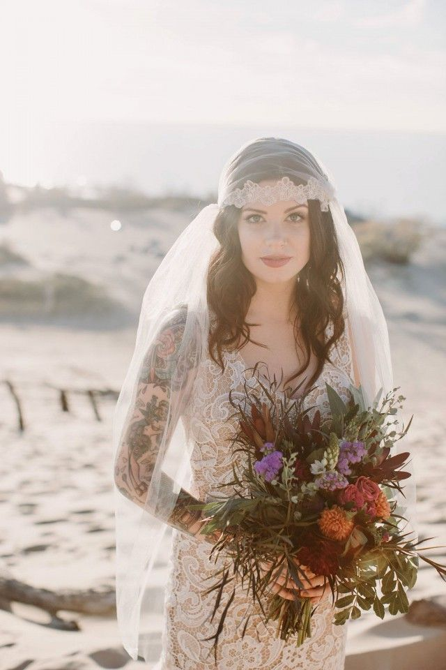 Boho-inspired elopement. Gown by Mignonette Bridal, lace Juliet cap veil by Richard Designs, photography by Megan Saul. Featured on RockNRollBride.