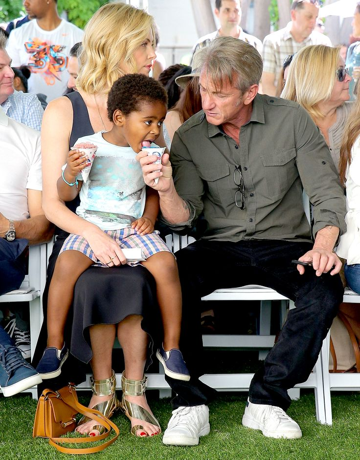 Sean Penn shares his snowcone with Charlize Theron's son Jackson