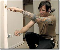 Tom DeLonge painting a door.