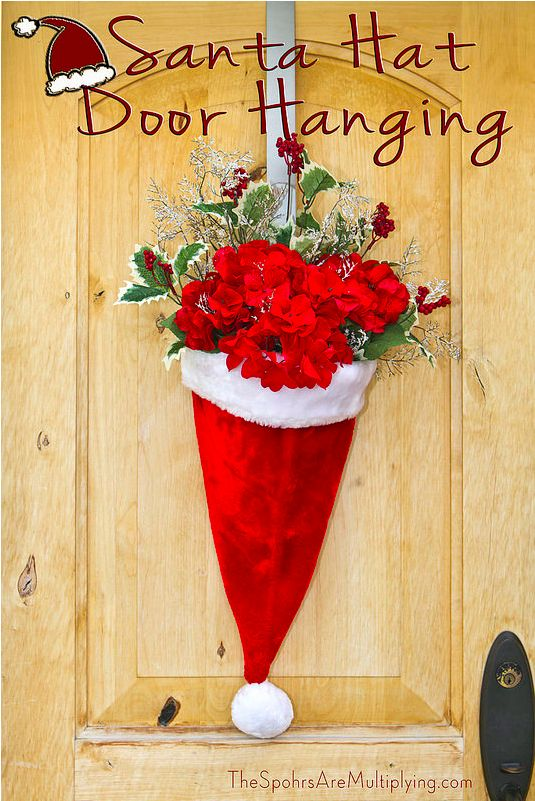 This adorable door hanging. | 27 Must-See Things For Parents Who Are Already Feeling Christmas