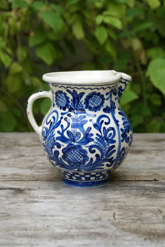 Handpainted blue and white ceramic pitcher, Korond, Romania  Sold for  €15.50