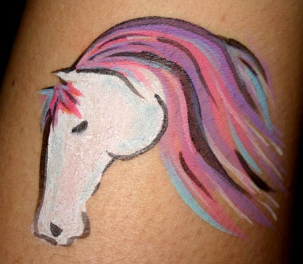 face painting. Add horn and it's the perfect unicorn