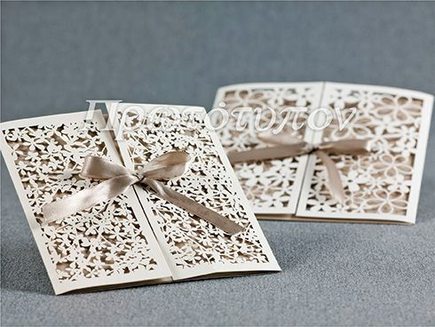 Lasercut Wedding Invitation combined with satin ribbon. Beautiful sand shades. Made by Prototypon