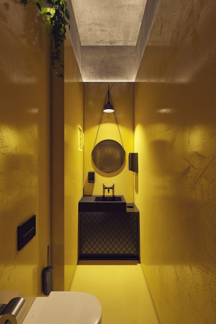 Желтые санузлы кажутся вырванными из общей эстетической концепции кафе. Но лофтовые элементы роднят не похожие на первый взгляд зоны одного интерьера.
