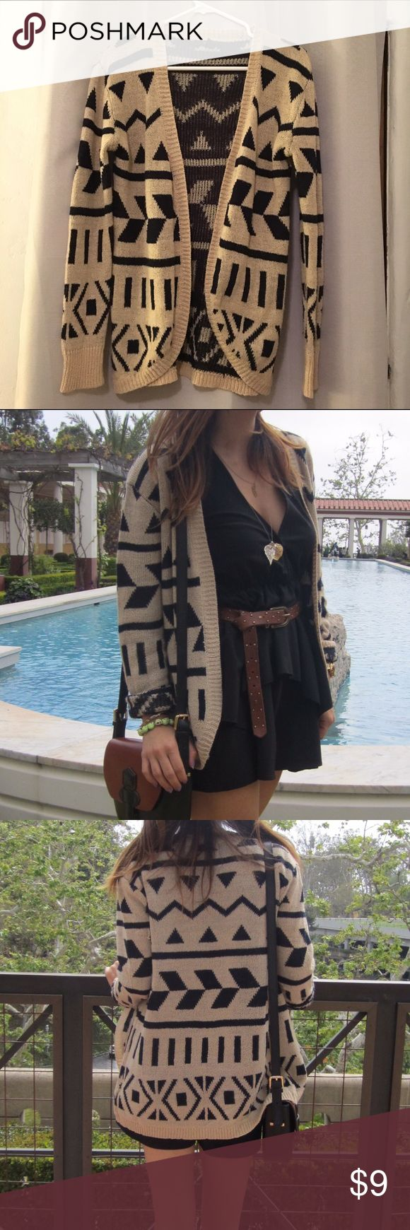 Forever 21 - tribal pattern cardigan, size S Forever 21 cardigan. Tribal print, light tan color with dark navy print. (Looks more black than navy to me.). Has 1 or 2 little snags, see pic.  Can be tied and snipped. Forever 21 Sweaters Cardigans