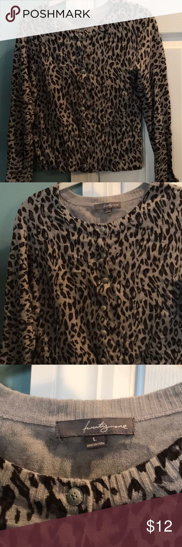 Leopard print cardigan sweater Leopard print button down cardigan sweater. Great condition. Size large Sweaters Cardigans