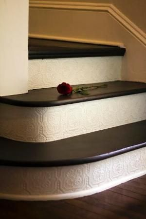 Add paintable and textured wallpaper on the stair risers - great DIY project, and affordable - under $30! by cathy