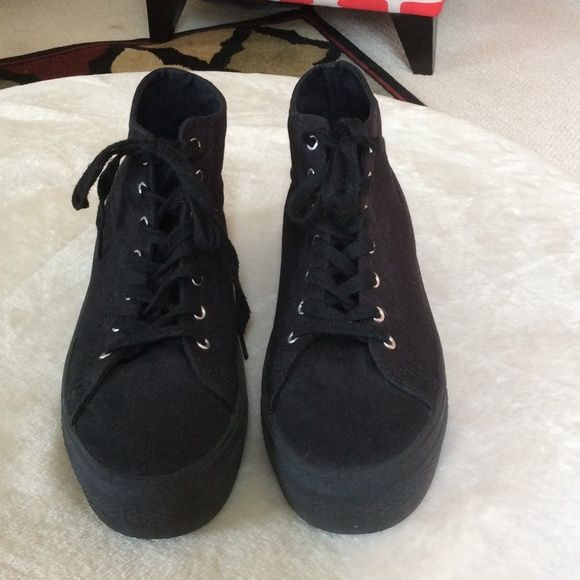 Black Canvas Platform Tennis Shoes by Soda Fun Platform Tennis Shoes. Worn a handful of times, but has lots of wear and life to them. Not from Hot Topic, just listed for reference. Brand is Soda Hot Topic Shoes Platforms