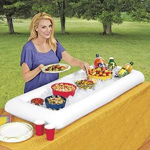 """INFLATABLE ICE BAR/ BUFFET.  Keeps foods and beverages chilled for hours! Jumbo serving station is roomy enough to hold multiple bowls, dishes, bottles and cans. Just inflate, fill with ice, set on table, and you're ready for picnics, parties, tail-gating, campouts, and serving large crowds indoors or out. Made of vinyl plastic. Folds flat to store. 54""""L x 22""""W x 4-1/2""""H.  $19.98"""