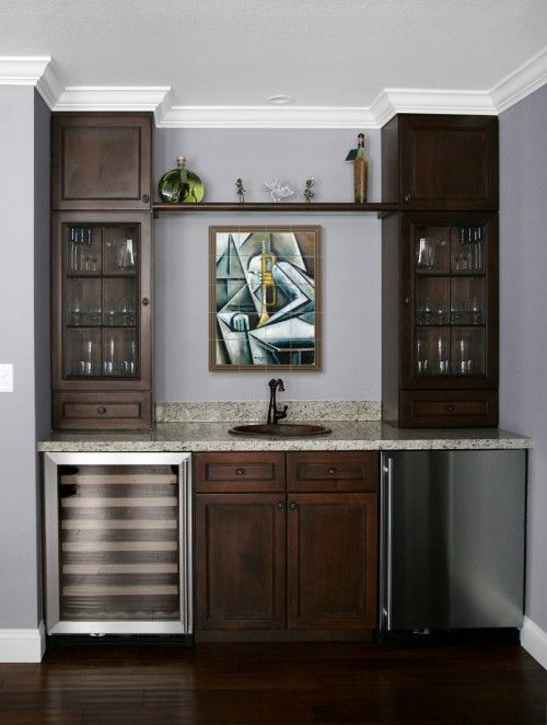 more of a transitional style wet bar design with a contemporary art focal point & nice shelf above