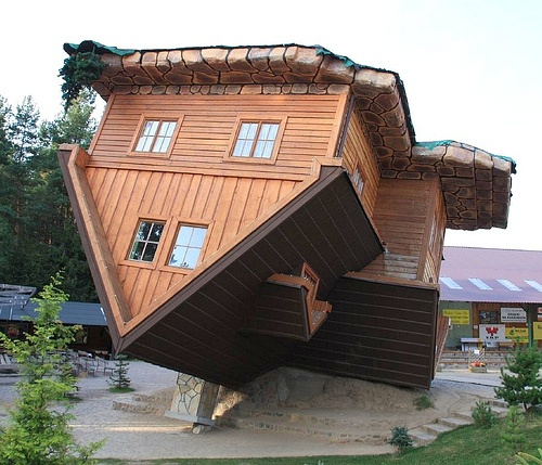 In Szymbark, Northern Poland, the timber construction company Danmar have created an upside down house. Danmar specialise in producing timber frame, wooden houses and have created a model village of examples of their work on a 1:1 scale. The upside down house is now a popular tourist attraction with thousands of visitors entering the model village. The house is also built on an incline which leaves visitors mildly seasick and dizzy as the strange angles make it difficult to find your…