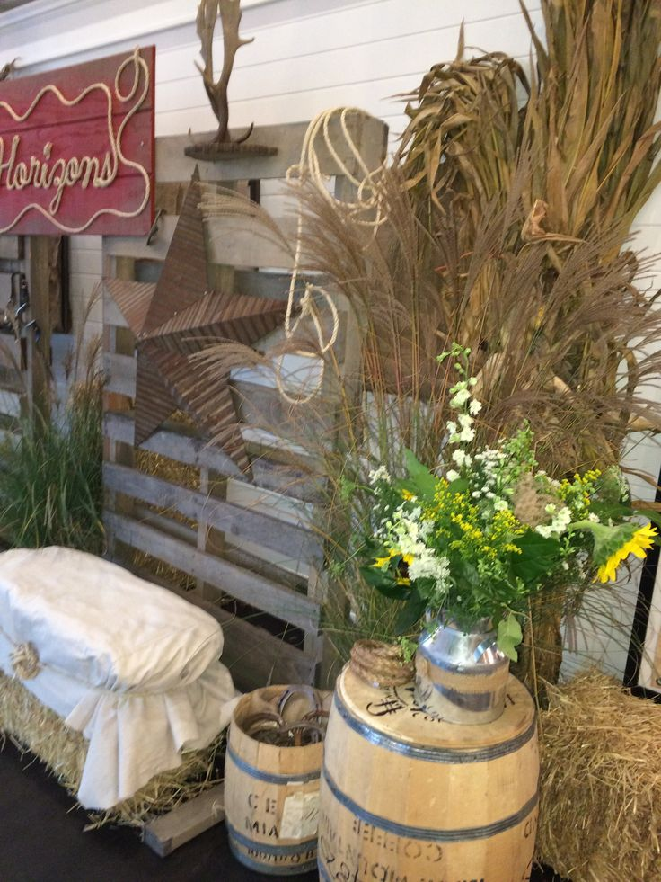 country western party; pallet backdrop, rope sign; draped-hay bale seating; barrels; by Two River Design