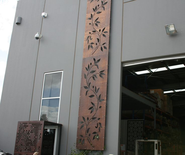 Along the left hand side of our factory is a tall vertical screen in the 'Maple Leaf' design made in corten, a rust-colored metal that suits outdoor use.  #decorativescreens #melbournedesign #exteriordecor