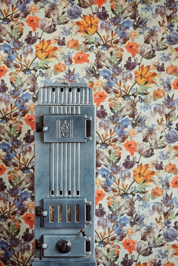 Masterpiece, E358013 by Eijffinger. This colourful floral wallpaper takes you into the intriguing world of old masters and exquisite details. The timeless play of light and shadow, once so skillfully immortalized on canvas, translated with verve into contemporary wallpaper. Available through Guthrie Bowron stores in New Zealand.