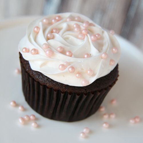 I love it when delicious meets elegant.  Isn't this the most darling cupcake?! Sprinkles - Pink Pearls for $5.50 from The TomKat Studio Party Shop