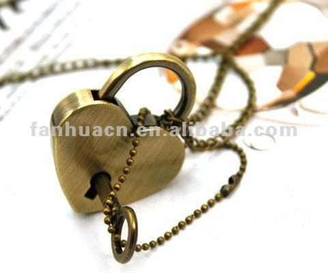 Necklace With Gold Plated Heart Engagement Ring And Lock