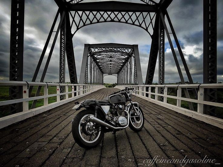 Quite the shot of his XS650 by @_caffeineandgasoline_ • #Repost @_caffeineandgasoline_ ・・・ Destroying the peaceful country quiet with air cooled twin braap one minute, stopping to take moody photos in the middle of old bridges then : nothing! PMA reg cooked, committing murder/suicide taking my near new @motobatt with it! A few hours on the side of the road and a taxi trip for a new @motobatt battery (and unplugged the reg) and it made it home (with lights off, no use of blinkers/stop lights)…