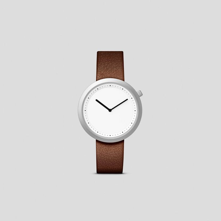 MATTE STEEL ON BROWN, ITALIAN LEATHER     Clean, classic and contemporary, Facette pays homage to the iconic, circular watch shape while incorporating distinct design details.
