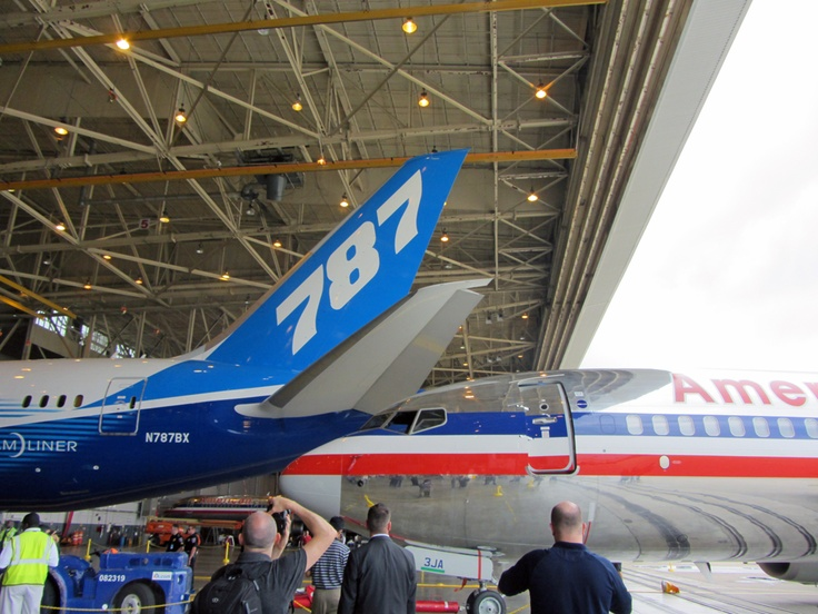 A Boeing 737 pulls in behind the Boeing 787 Dreamliner in an American Airlines hangar at DFW Airport.
