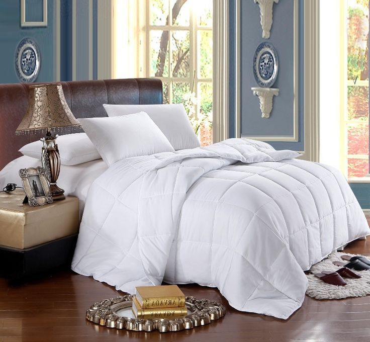sleep in luxurious comfort with this overfilled down alternative white comforter it has an extremely