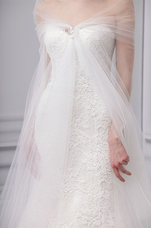 Delicate & beautiful. A tulle, floor-length, overlay with small silk buttons makes the bride appear ethereal.