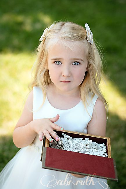 flower girl ideas; puzzle piece shapes cut out of book pages, dropped out of a hollowed out book; 13 clever diy ideas from my cousin's wedding » Abi Ruth
