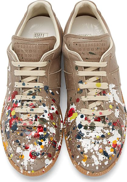 Grey Paint Slash Replica Sneakers by Maison Martin Margiela. Low-top leather sneakers in gray. Round toe. Off-white lace up closure. Tonal logo patch at tongue. Glossy multi-coloured paint splash throughout. Contrasting beige rubber sole. Tonal stitching. Upper: leather. Sole: rubber. Made in Italy. http://www.zocko.com/z/JFNNI