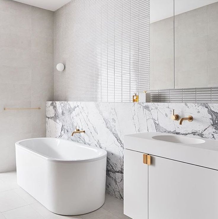 This gorgeous bathroom at SkyOne, Box Hill by DKO Architecture features our Arki 900 basin. Love it!