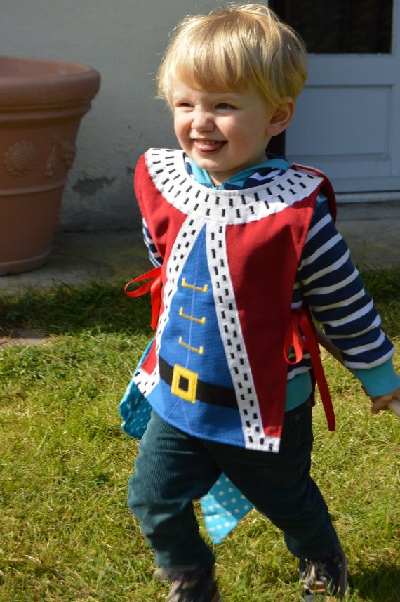 ♥ This king costume is perfect for parties, plays and make believe games. Lovingly handmade, it can simply be worn over your childs normal clothes and is tied at the sides with ribbons.  ♥ Available in ages 1-10.  ♥ 100% designed and handmade by Toots & Me here in the south of France  ♥ Well made with care from cotton so this costume can be worn time and time again.  ♥ This little guy can be machine washed and tumble dried on a cool cycle.  ♥ Once purchased, your order will be shipped within…