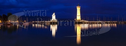 Entrance of the harbour with the Bavarian lion and the lighthouse, Lindau, Lake Constance, Bavaria, Germany @WorldPanoramaStock #stock photo