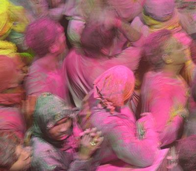 The Story of India: Pakistan and North India: Holi has become one of India's best-loved festivals. Traditionally associated with the coming of spring, friends gather during the day for 'holi parties' where they douse each other with coloured powder and water. The throwing of powder has a hidden significance as the colours were originally made of 'neem' and 'haldi' (tumeric), which are believed to contain properties that help stave off illnesses that come with the changing weather.