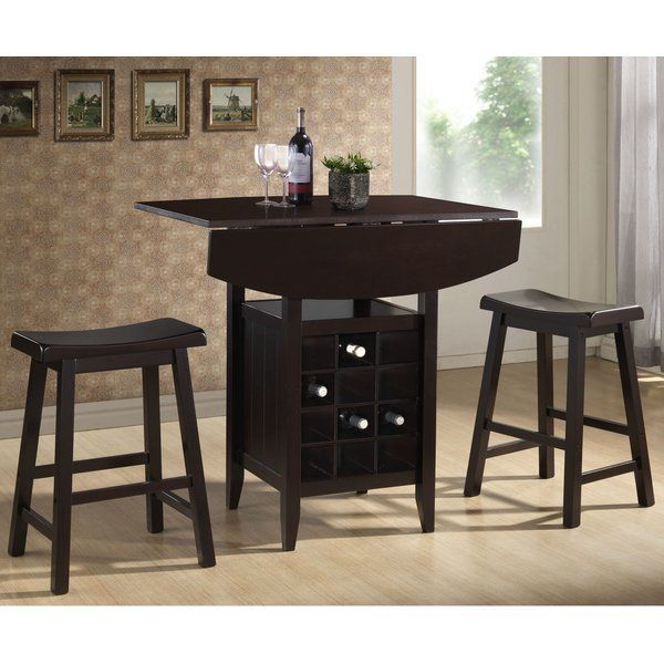 The Latitude Run Elida 3 Piece Pub Table Set will transform your living space with its contemporary design. This pub table set is part of the Elida collection and includes a pub table and a pair of saddle stools. The table is made of wood, making it sturdy and durable. It sports a black finish that blends in well with most decors. The Elida 3 Piece Pub Table Set by Latitude Run has a standard shelf and inbuilt wine rack for organized and easily accessible storage. As an eco-friendly design…