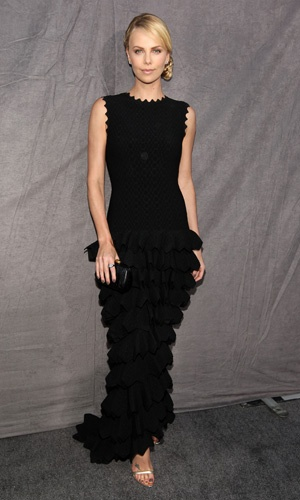 Charlize Theron arrived at the Critics Choice Movie Awards 2012 looking super stylish in a Azzedine Alaia gown.