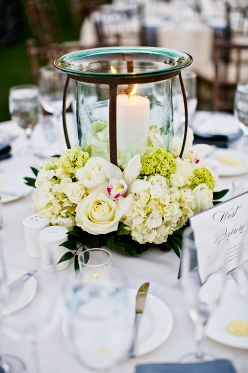 Green and cream flowers with candle | Floral Design by Outstanding Occasions Photo by Jennifer Bowen