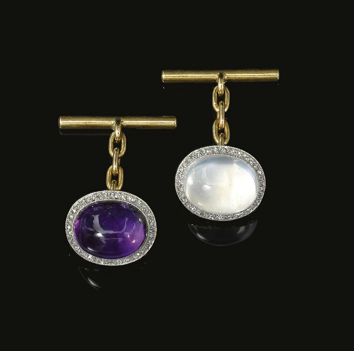 Pair of gem set and diamond cufflinks, circa 1900. Each set respectively with a cabochon moonstone and amethyst, each with a border of rose diamonds | diamanten-haeger.de