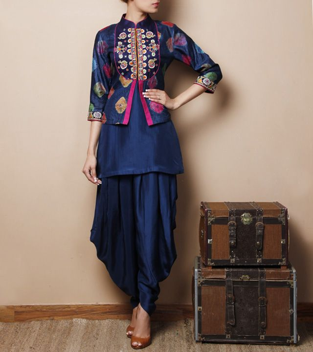 Blue Silk Kurti with Jodhpuris and a jacket that has a tie-dye design, mirror embroidered yoke and pink piping...