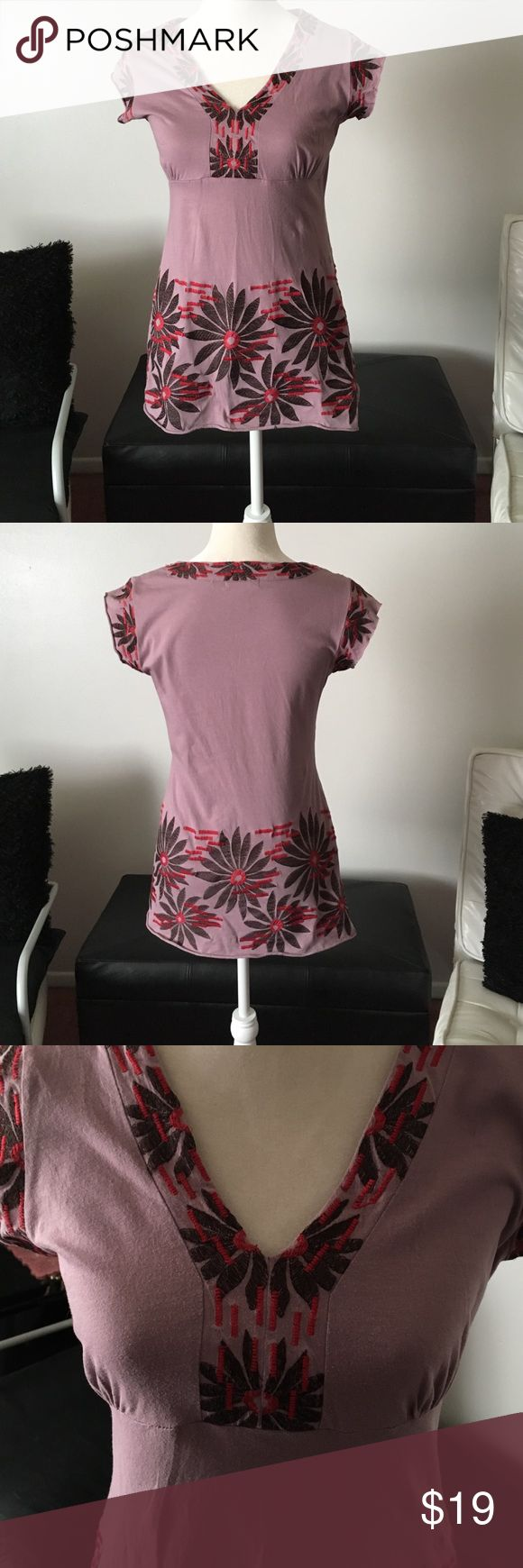 BCBGMaxazria Top In very good condition with the exception of very small hole that I had sewn. Happened when I removed the tags. Plz look at pic #4. It is on the top back neck near the tags. Not really noticeable (my opinion). Bust /chest measures approx 17.5 inches. Length is approx 27.5. This runs small so would fit small or medium better. Again my opinion. This has the raw edges on the sleeves and bottom part of top BCBGMaxAzria Tops