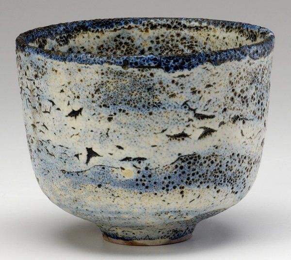 "NATZLER Earthenware bowl covered in blue and white ""crater"" glaze"