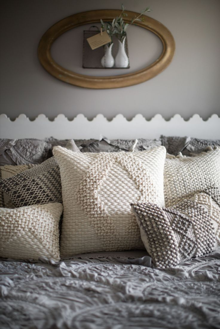 When in doubt, go neutral and textural. Magnolia Home by Joanna Gaines pillows.
