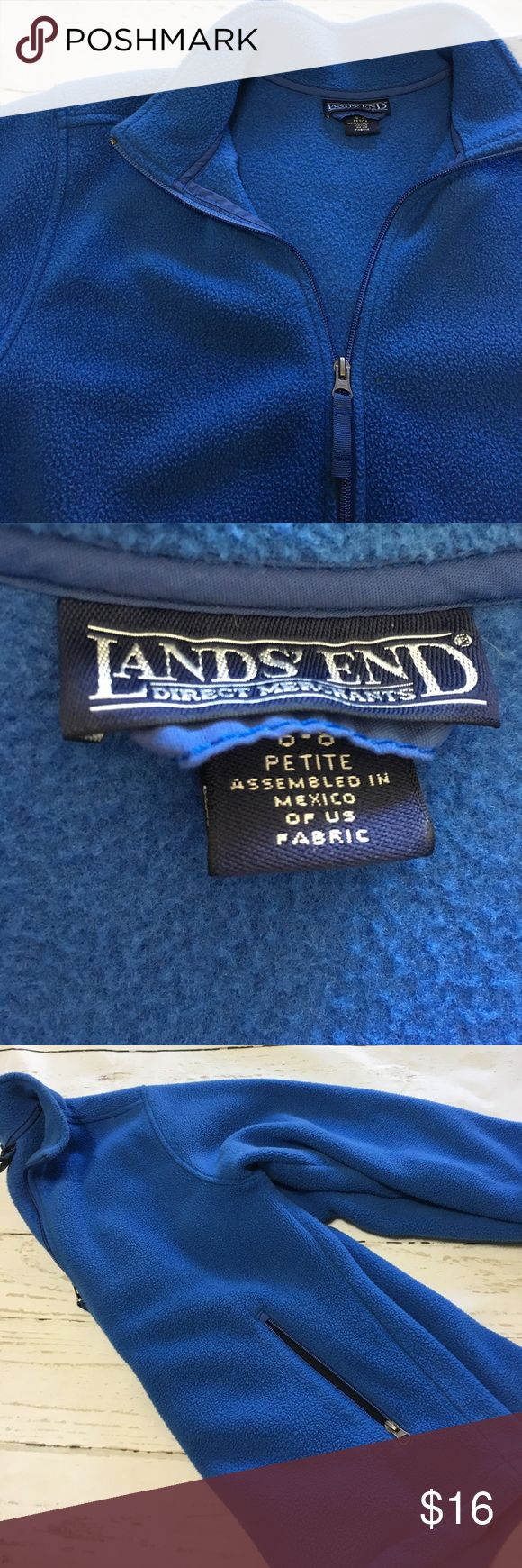 Lands End Small Blue Zip Up Fleece We love these for camping!   This is preloved and though it has no stains or tears it does show the fleece signs of washing so please check pictures.  It is priced accordingly.  Zip up and zip pockets are in perfect condition.  It's a size small Petite (6-8) however it fits a regular 4-6 and Smaller 8 just fine. Lands' End Tops Sweatshirts & Hoodies