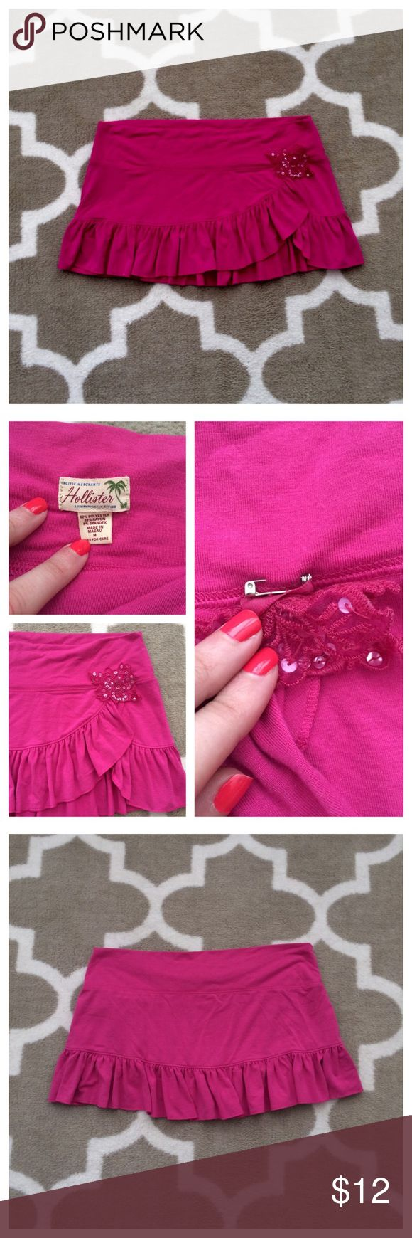 Hollister Skirt Cute skirt from Hollister in a bright disc his color. Comes with a sequined lacy pin but this can be removed. The style would be perfect to use as a swim suit cover up if you are going for a sarong look. Hollister Skirts Mini