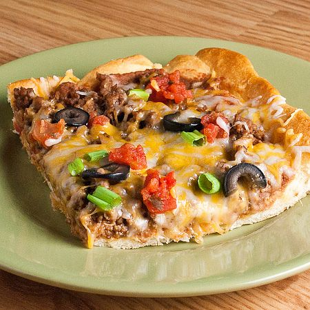 Taco Pizza    1 lb. ground beef  1 envelope taco seasoning mix  2 (8 oz.) cans Pillsbury crescent rolls  1 (16 oz.) can refried beans (I used thejalapeñokind)  2-3 cups shredded cheddar cheese orMexicanblend  1/2 cup chopped tomatoes  1/4 cup sliced black olives  4 green onions, chopped  Heat oven to 375 degrees.  Brown ground beef and drain. Add taco seasoning to the ground beef according to the package directions.  Unroll crescent rolls into rectangles. Place in ungreased 11 1/2 inch x…