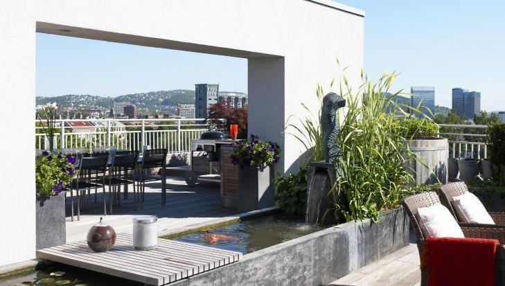 ENORM TAKTERRASSE: Terrassen er inspirert av japansk hagekunst, som gjenspeiler naturen og binder terrassen sammen med omgivelsene. Foto: Es...